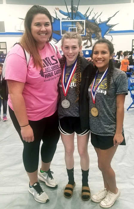 Yoselin (1st) and Maurs (2nd) with Coach Foster at the Regional Powerlifting Meet.